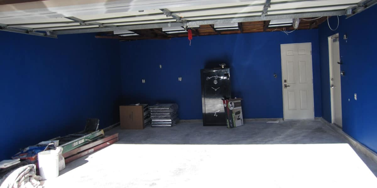 empty garage painteed blue and ready for new cabinetry