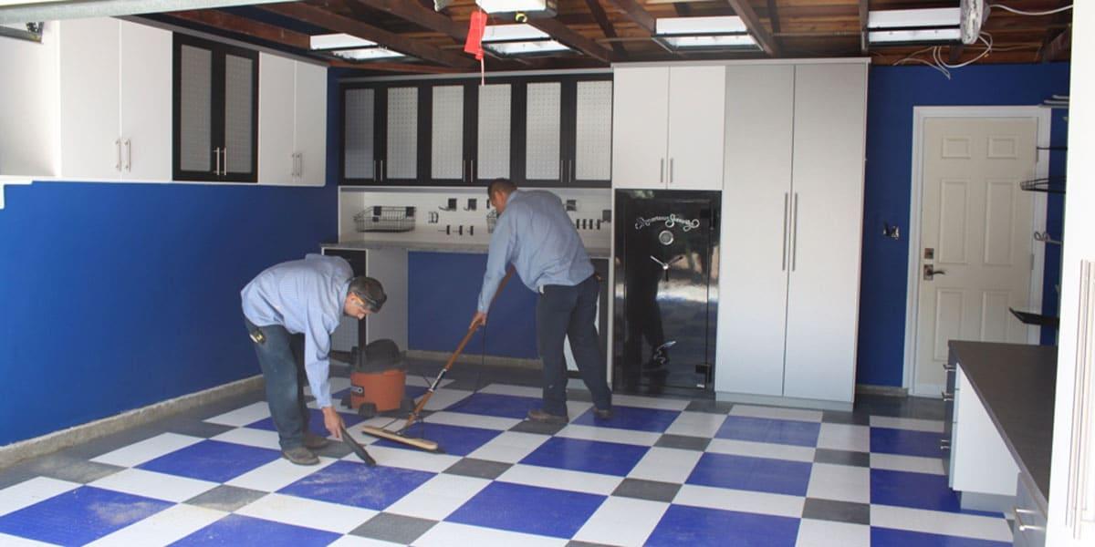 2 men working on a custom garage build