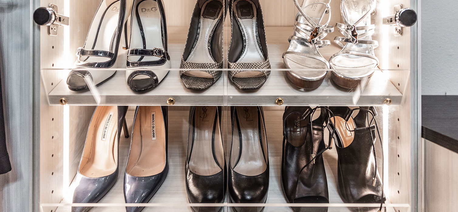 pairs of shoes organized flat on shelves