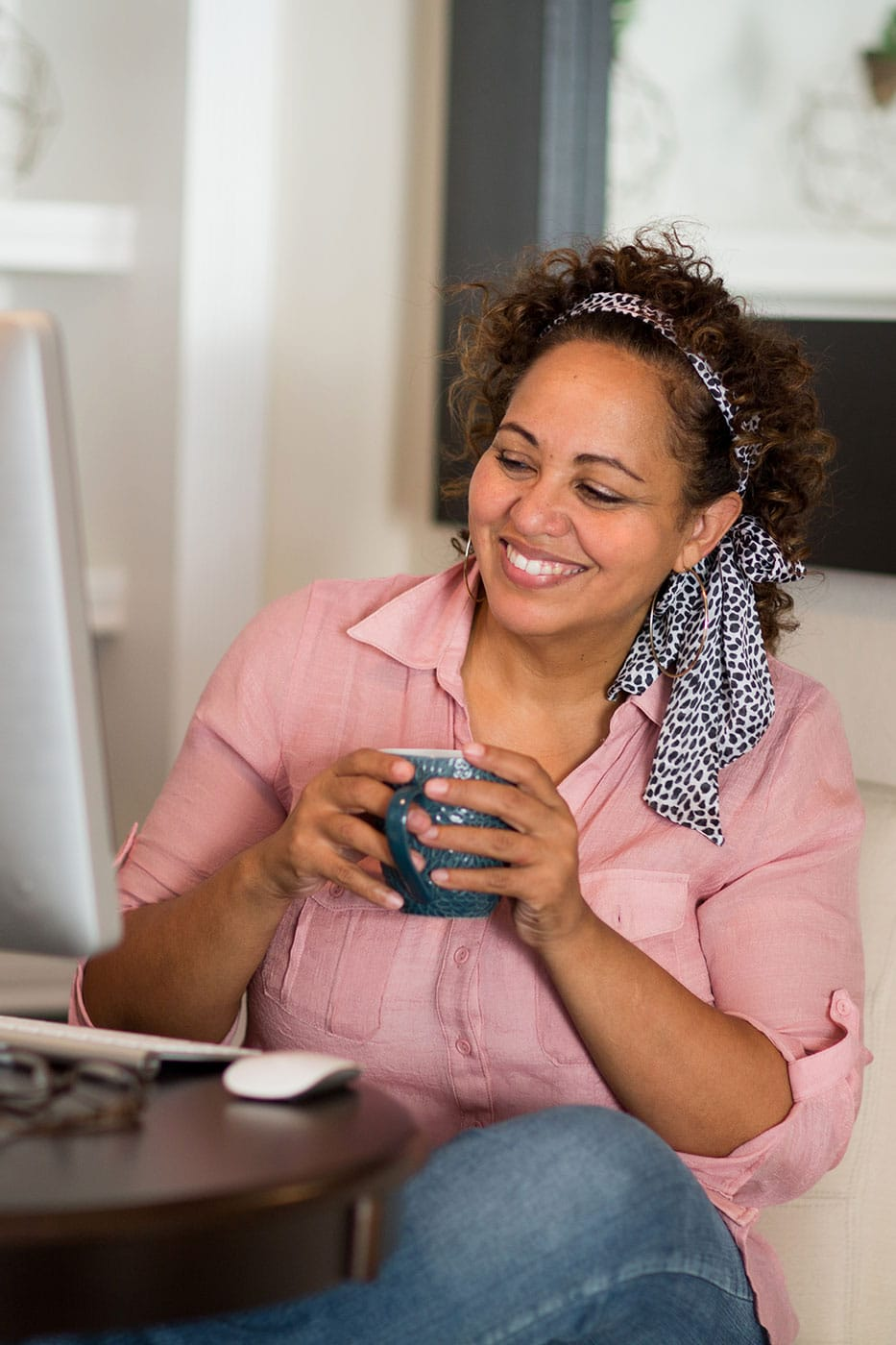 office woman drinks coffee at her desk