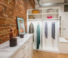 closet with brick wall behind the system