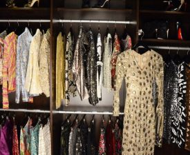 clothing in a wood custom closet