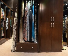 wood custom closet with cabinet