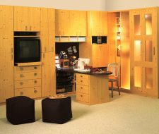 Custom cabinetry for a sewing room in knotty pine.
