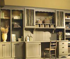 Paint grade workstation with olive color fabric in cabinet doors.