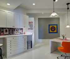 basement craft space with custom designed and installed art drawers