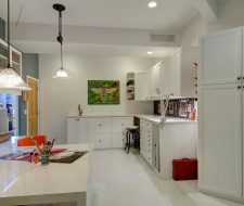 Basement craft room in high gloss white feature cabinets