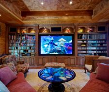 Wall-to-wall and floor-to-ceiling solid wood entertainment center
