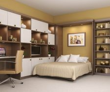 white and wood wall bed and office