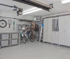 grey cabinets and work office in garage