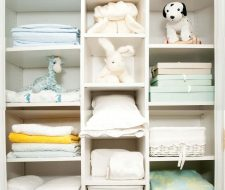 linen closet with toys and blankets
