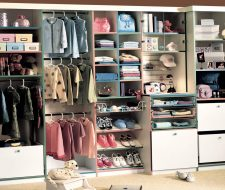 white kid closet with hampers and colored edges