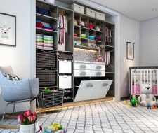 infant custom closet with changing station and hampers
