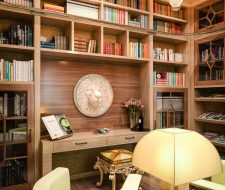 built-in library shelving in wood floor to ceiling