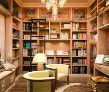 Very high-end library shelving is custom design and installed in a small bedroom.
