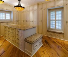 solid wood walk-in closet design with island