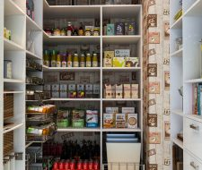 coffee wall paper in walkin pantry with corner shelving