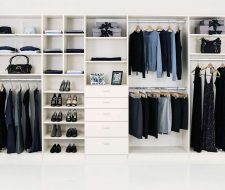 soft white reach-in closet with drawers