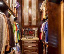 Narrow man's walkin closet in wood