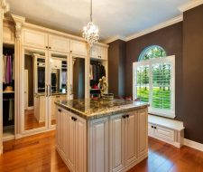 Wood traditional walk-in closet and island