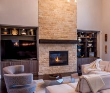 TV cabinet surrounds fireplace with storage above.