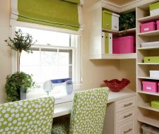Craft room storage cabinets in a closet filled with storage and supplies