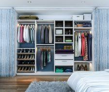 woman's closet with handbag cubbies and slanted shoe shelves