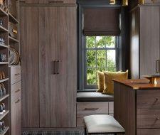 Man's custom walk-in closet in wood with black crown