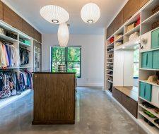 Two tone modern closet with wood island