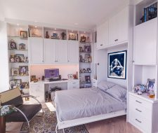 white home office includes wall bed